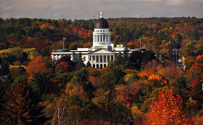 The State House is surrounded by fall foliage Monday, Oct. 23, 2017, in Augusta, Maine.
